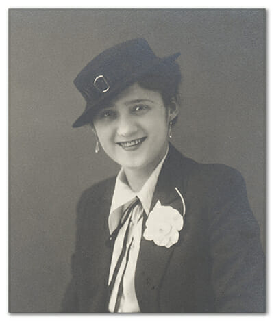Aunt Adel smiling with Hat and Flower