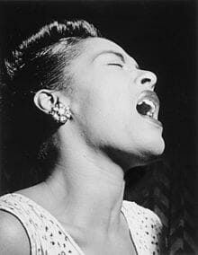 Photograph of Billie Holiday singing.