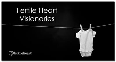 Baby's onesie hanging on clothesline Fertile Heart Visionaries