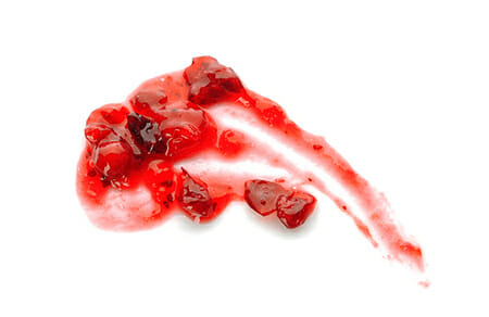 Cranberry Sauce Splatter on White Background