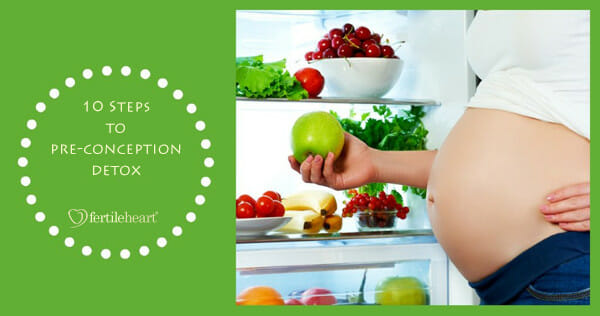 Pregnant Woman reaching for apple from bountiful fridge
