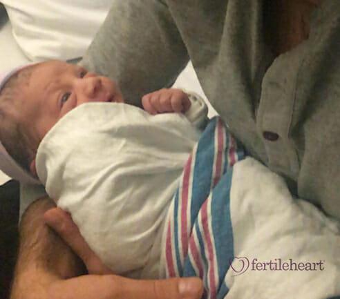 Father Holding Newborn Fertile Heart