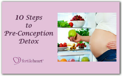 Pregnant woman holding apple in front of fridge - 10 Steps to Pre-Conception Detox fertileheart